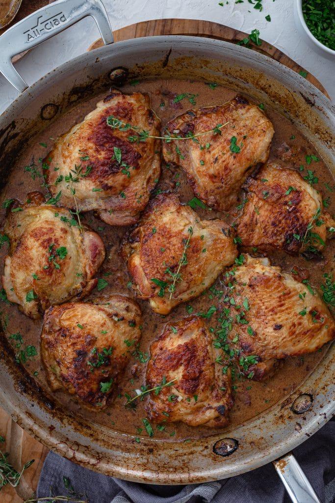 Chicken thighs braised in a mustard sauce.
