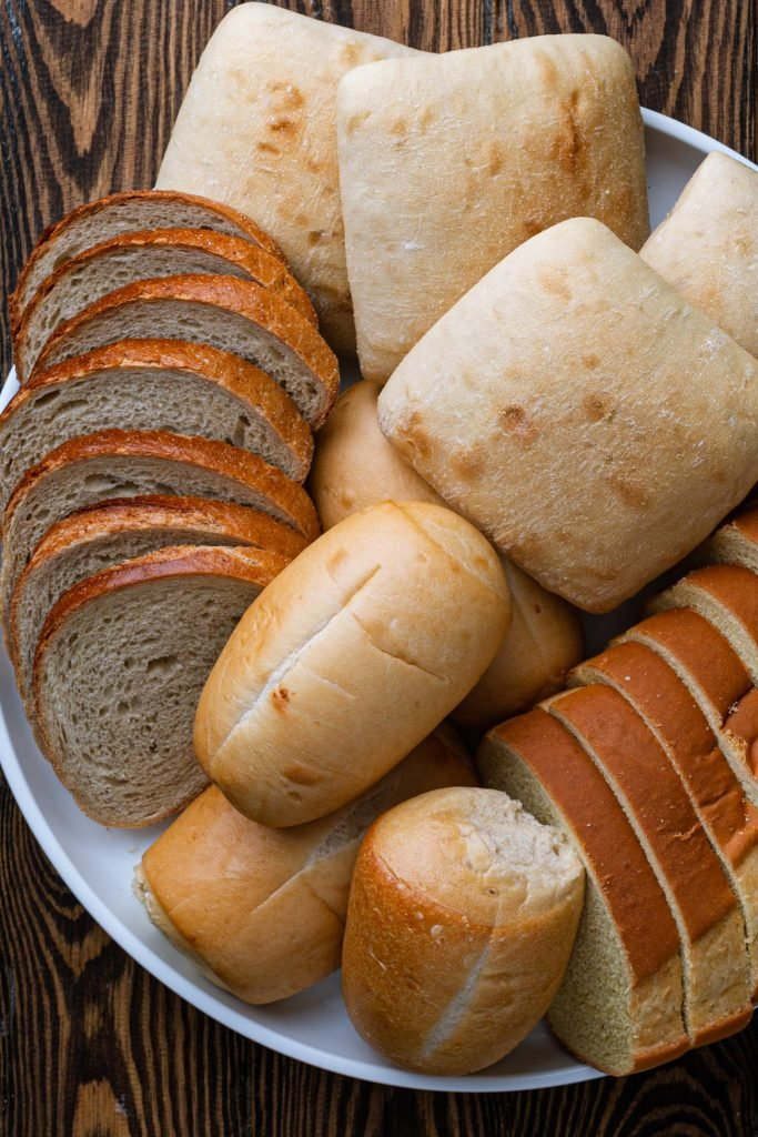 A platter with several different types of bread.