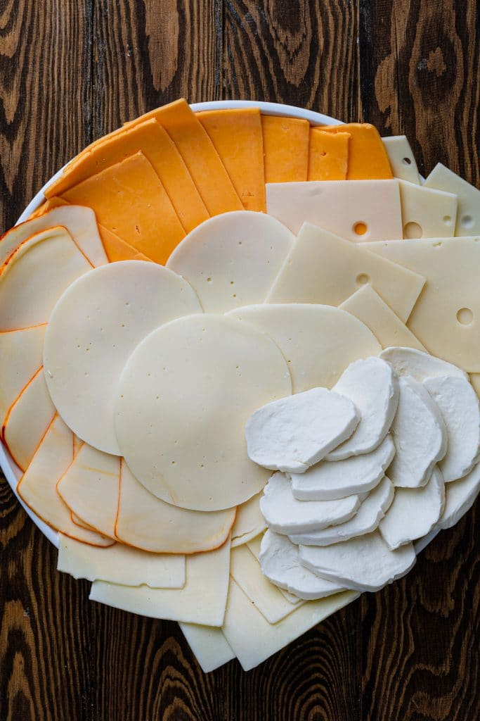 A platter with different kinds of cheese.