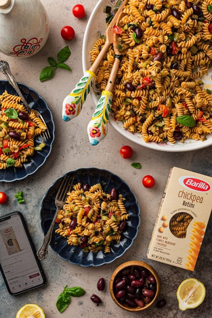 Overhead photo of the pasta with a box of Barilla and a cellphone with the shopping page.