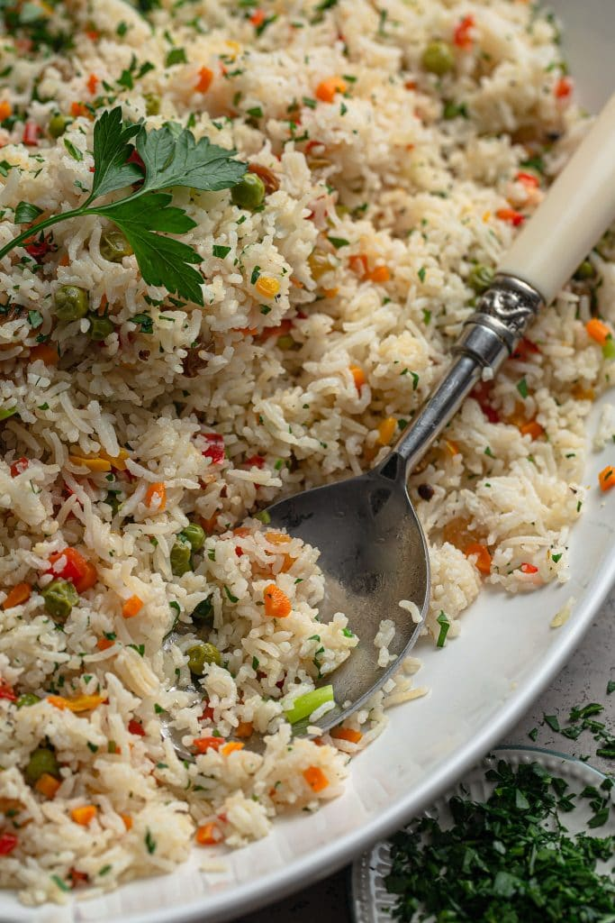 A close up shot of the rice pilaf and a serving spoon.
