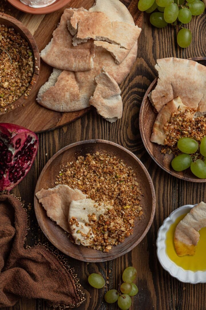 Dukkah served with pita bread, olive oil and fresh fruit.