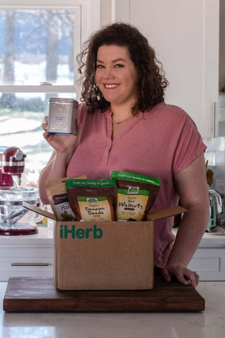 Olivia from Olivia's Cuisine opening a box from iHerb.