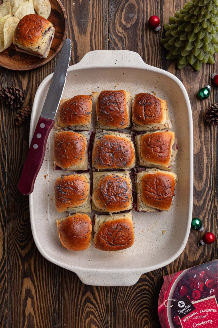 A baking dish with turkey cranberry sliders.