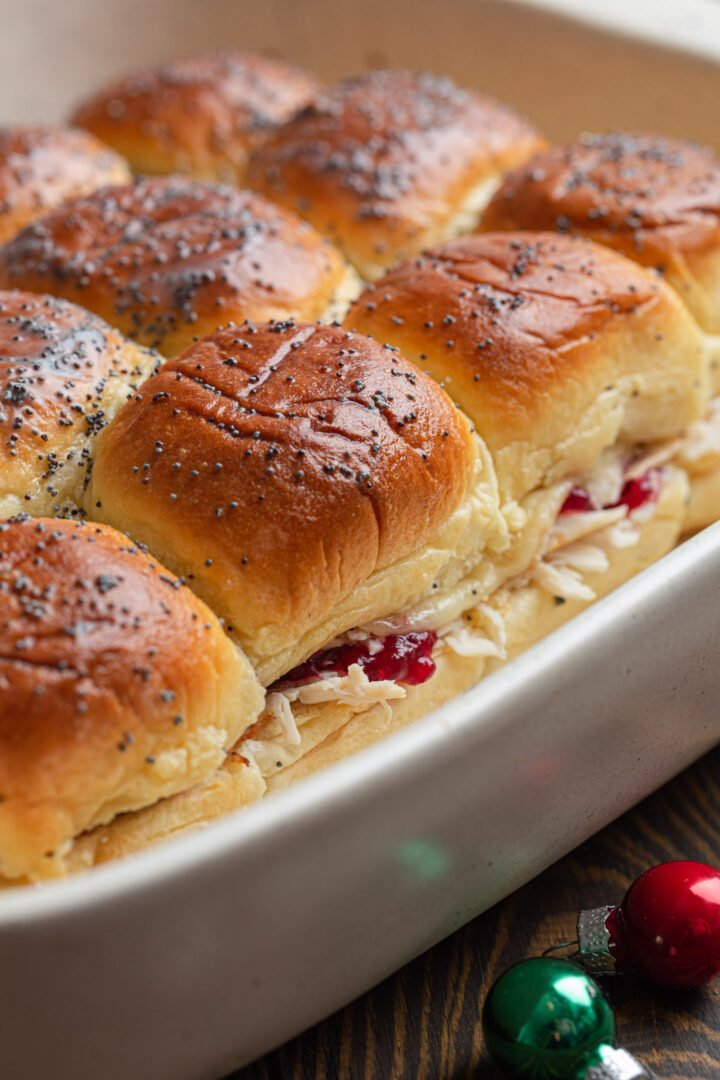 A baking dish with leftover turkey cranberry sliders.