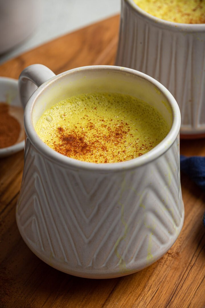 A close up shot of a mug of Turmeric Latte.