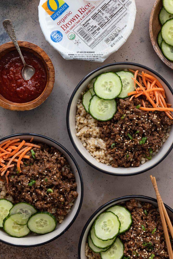 3 Korean Beef Bowls, served with Gochujang sauce.