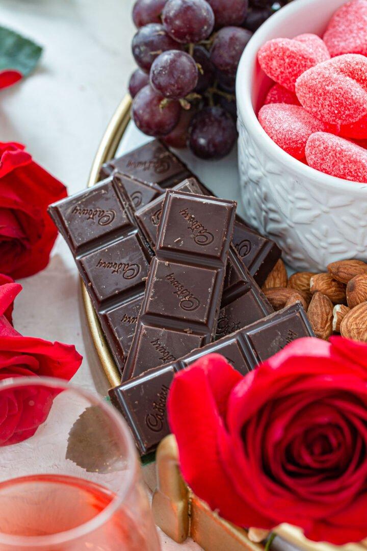 Dark chocolate rows on a Valentine's Day dessert board.