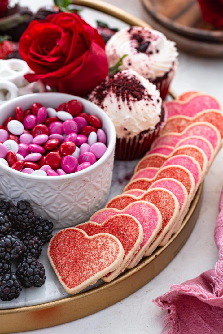Heart shaped cookies on a dessert board.