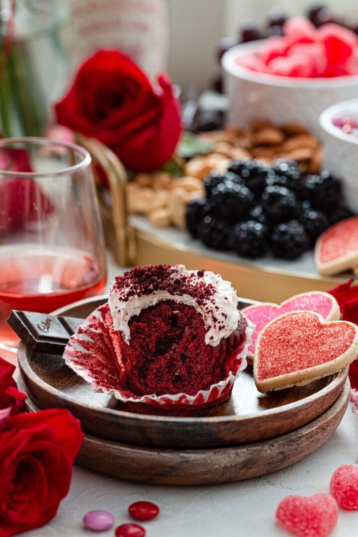 A half eaten Red Velvet Cupcake.