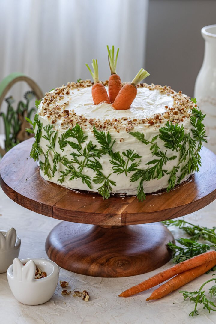 An Easter carrot cake on a cake stand.