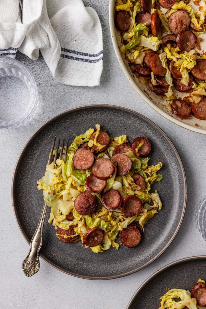 An individual plate with Sausage and Cabbage Skillet.