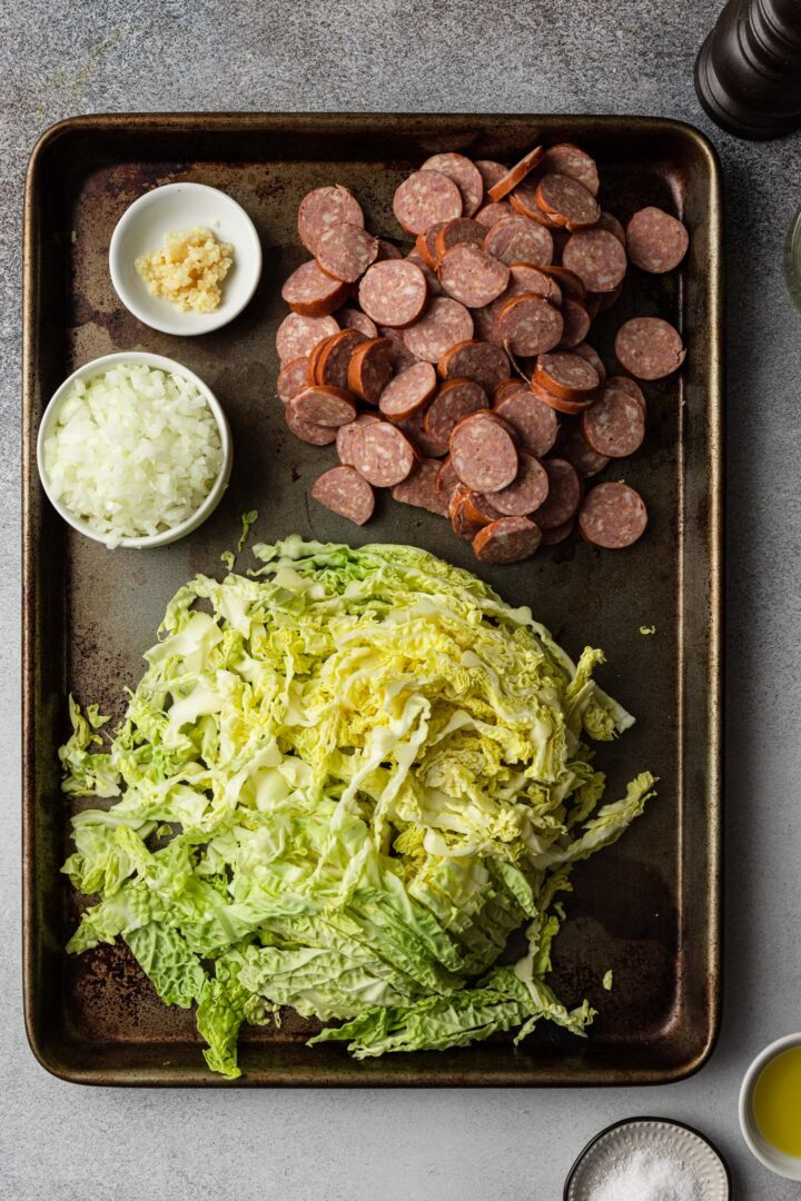 Shredded cabbage, sliced sausage, minced onion and garlic.