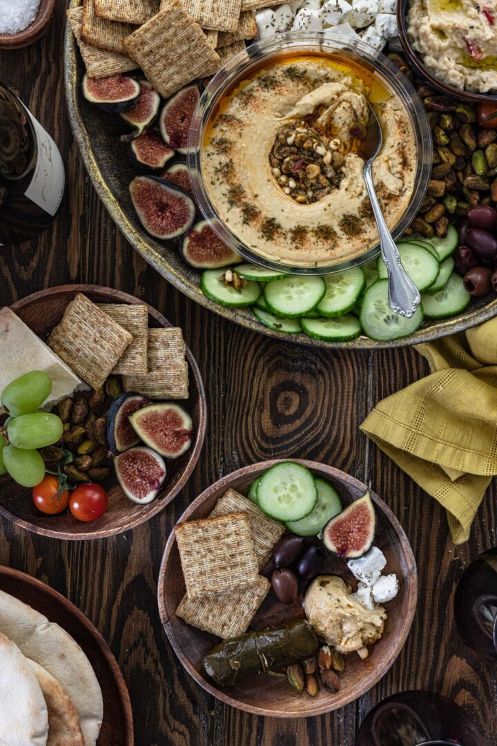 Serving a mezze platter. You can see the large platter and two individual servings.