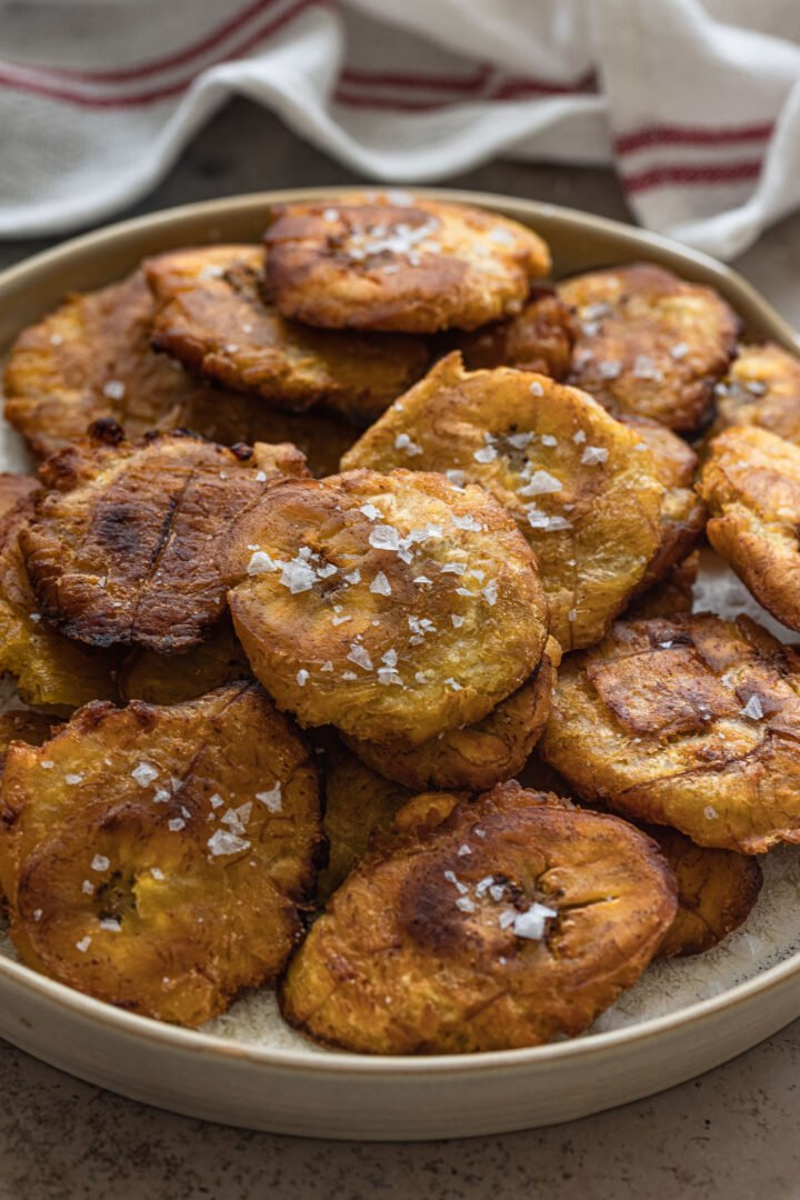 A close up photo of tostones chips.