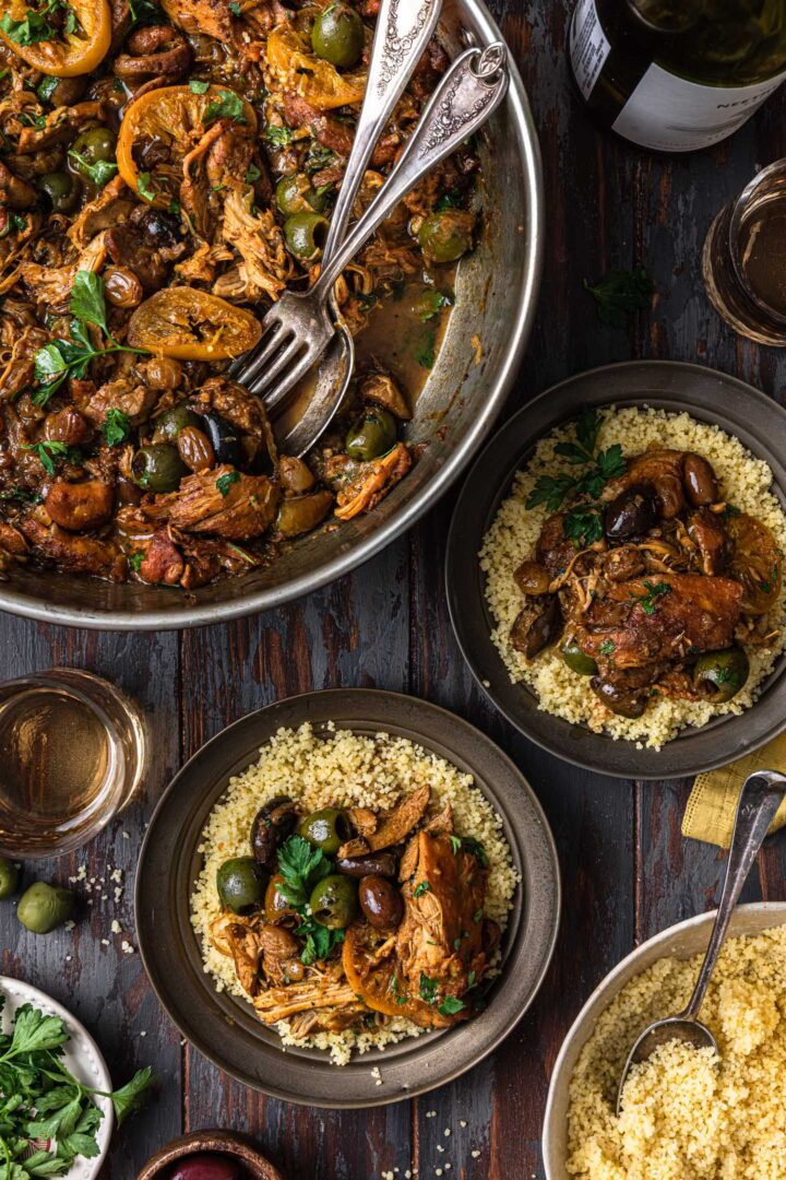 Serving chicken tagine. A pan with the chicken tagine and two individual portions served over couscous.