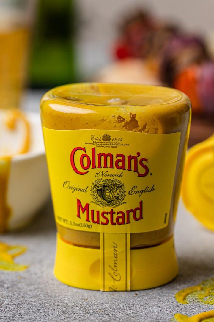A bottle of Colman's mustard.