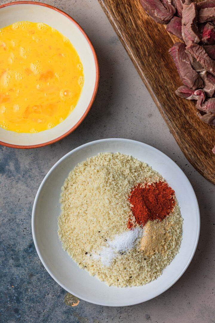 Breadcrumbs mixed with seasoning.