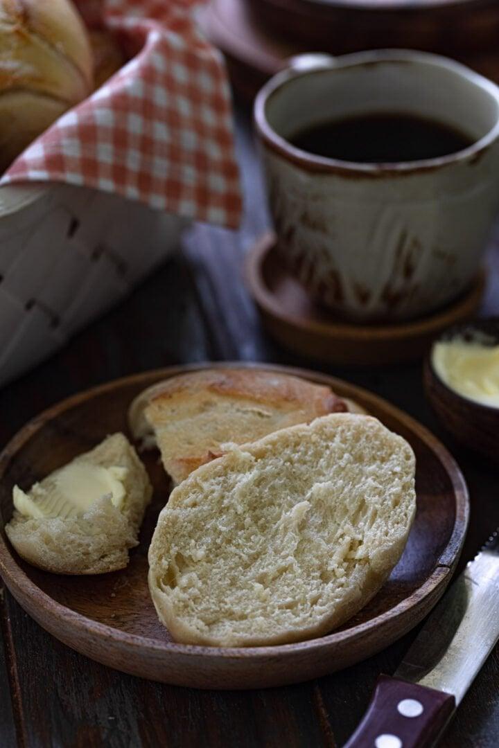 A pan frances split open to show the soft crumb.
