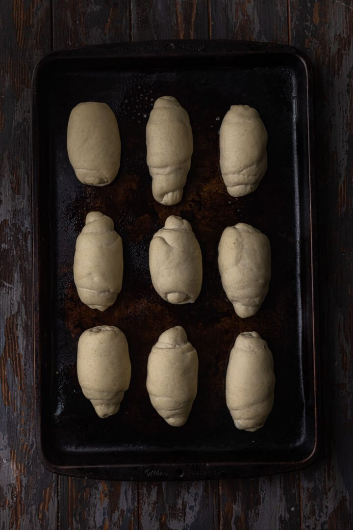 Pão francês rolls proofed and ready to bake.