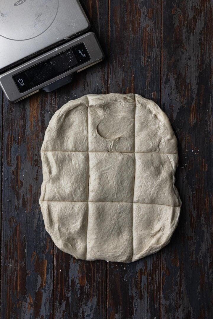 Dividing the dough into 9 equal parts.