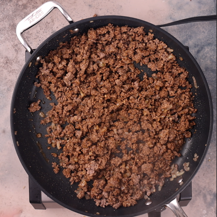Browning ground beef.