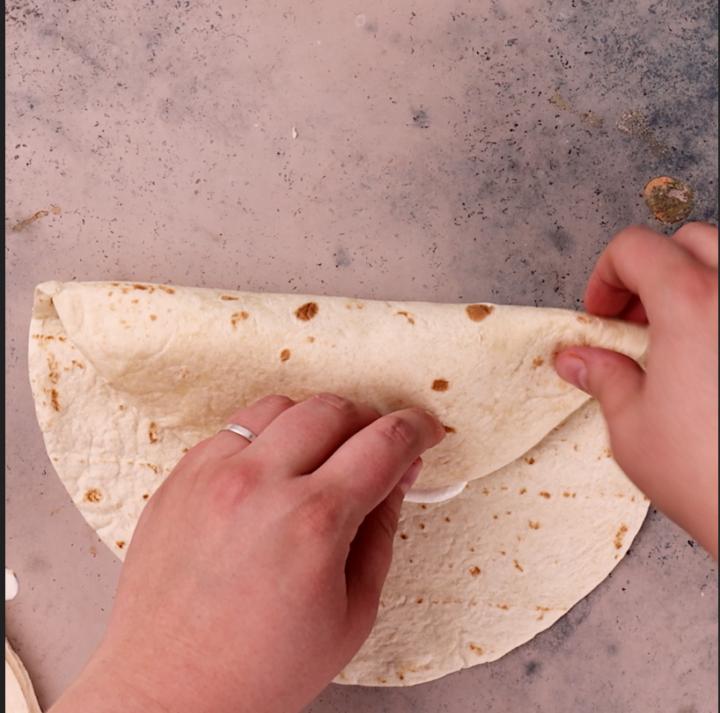 Rolling a burrito.