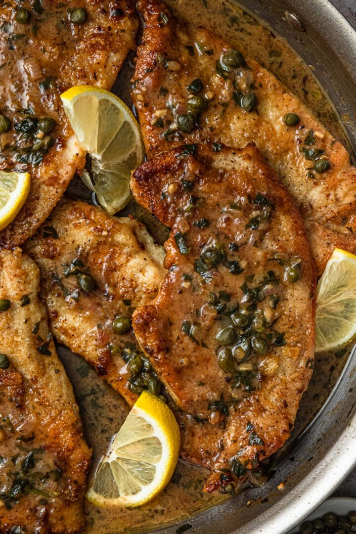 A close up photo of chicken piccata.